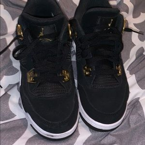 Black and gold Jordan retro 4s